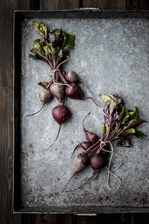 bunched: Bundles of beetroot on a baking tray