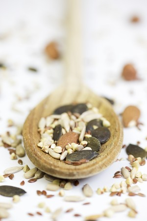 vintage: Nuts and seeds on a wooden spoon