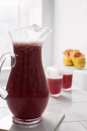pinky: Freshly pressed grapefruit and pomegranate juice in a glass jug