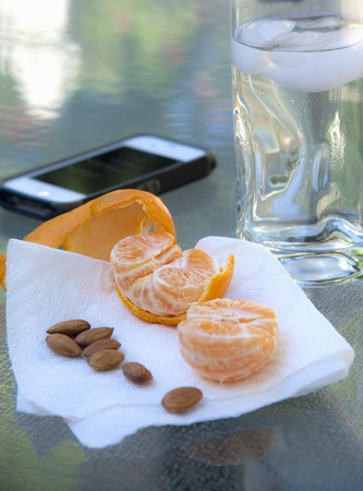 A mandarin and almonds as a snack LANG_EVOIMAGES