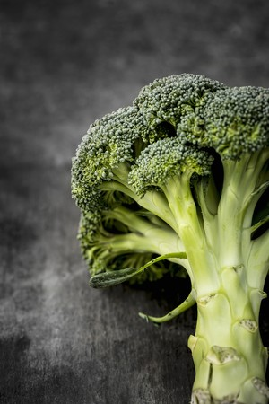 Broccoli on a grey surface LANG_EVOIMAGES