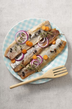 Pickled herring fillets with spices, onions and carrots LANG_EVOIMAGES