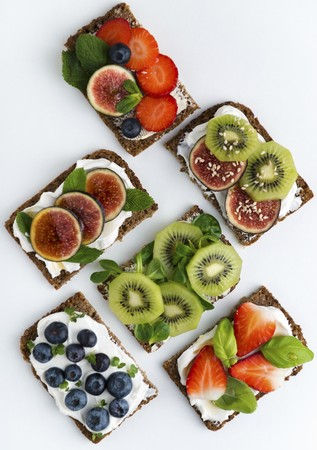 Wholemeal open sandwiches topped with soya quark and various fruits