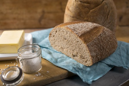 cutting: Sourdough bread with butter and salt