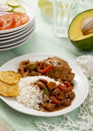 banana: Braised chicken with beans, rice and tostones (Dominican Republic)