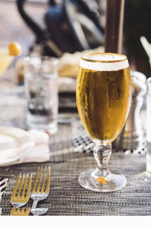 A glass of ice cold beer LANG_EVOIMAGES