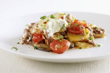 Potato, minced meat and tomato bake LANG_EVOIMAGES