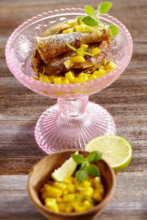 pinky: Sweet plantain pancakes with mango salad