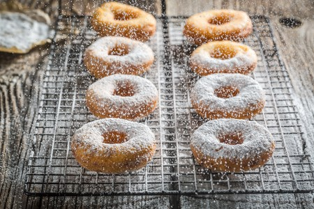 Freshly baked doughnuts dusted with icing sugar LANG_EVOIMAGES