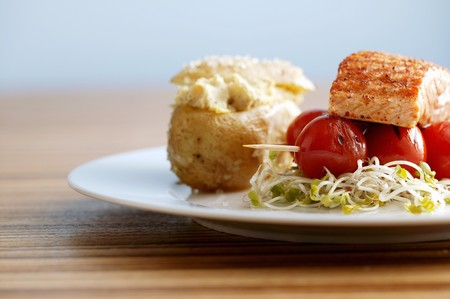 bean sprouts: Salmon fillet on a bed of radishes and bean sprouts with a jacket potato LANG_EVOIMAGES
