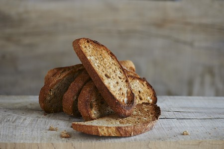 Toasted seven grain bread on a wooden surface