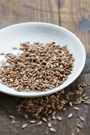 A bowl of brown flax seeds