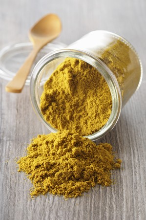 Curry powder in an overturned glass LANG_EVOIMAGES