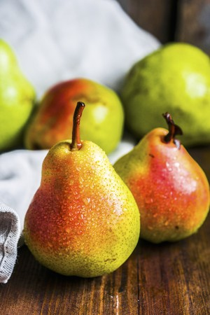 Fresh pears on a wooden surface LANG_EVOIMAGES