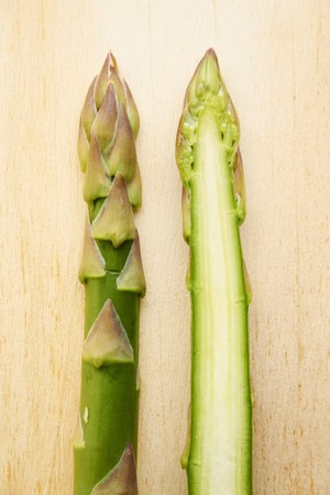 A halved spear of green asparagus