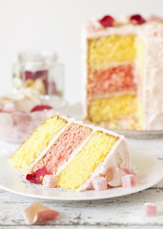 gateau: A slice of Turkish Delight layer cake with rose petals LANG_EVOIMAGES