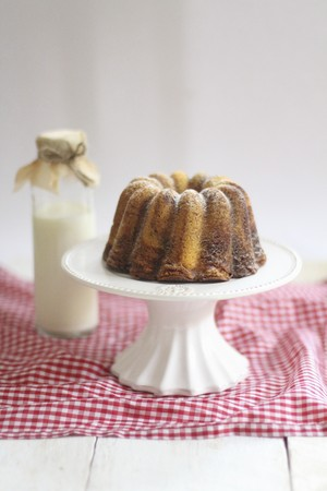 whiteness: A marble cake on a white cake stand