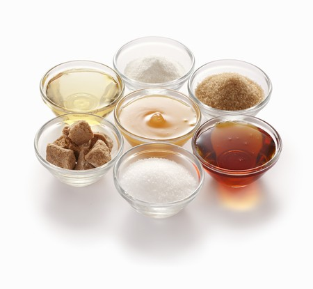 Natural sweeteners – clockwise from top: stevia, cane sugar, maple syrup, beet sugar, coconut flower sugar, agave syrup and honey LANG_EVOIMAGES