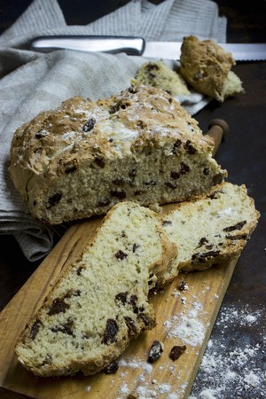 Genuine Irish soda bread, sliced, on a wooden board