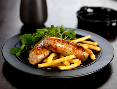 pork and ale sausages with french fries and watercress LANG_EVOIMAGES