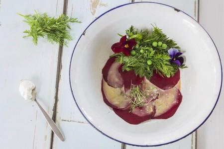Beetroot carpaccio with a herb salad