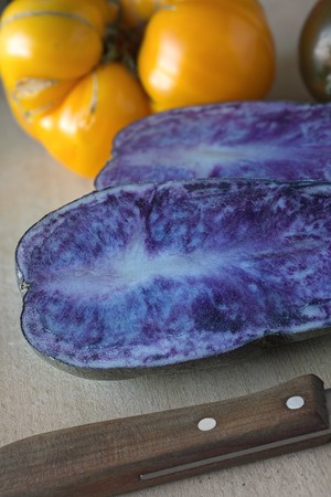 Blue potatoes and a pineapple tomato (close-up)