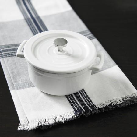 whiteness: A white pot on a napkin