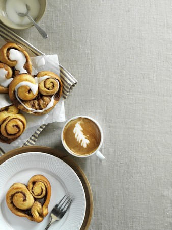 bakery products: Cinnamon buns and a cappuccino