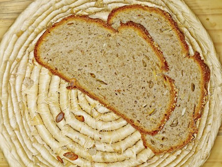 breadbasket: Two freshly cut slices of pumpkin and spelt bread in a breadbasket