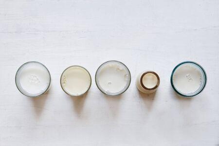 Various types of vegan milk in glasses