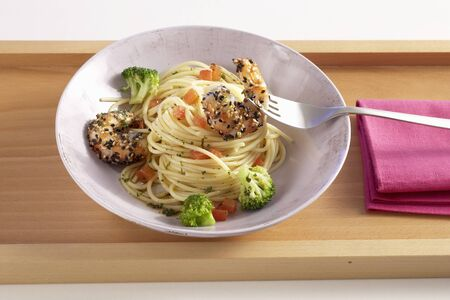 Spaghetti with sesame seed prawns and broccoli