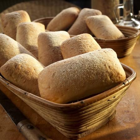 Ciabatta rolls in a wooden basket