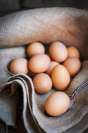Brown eggs on a piece of jute