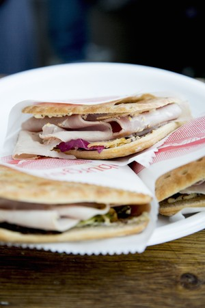 collation: Ham on unleavened bread wrapped in paper on a plate