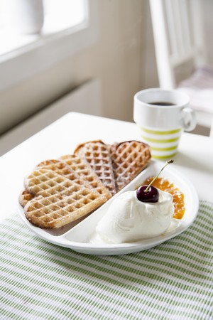 chicouté: Heart-shaped waffles with vanilla ice cream and cloudberry jam