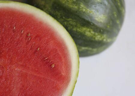 halved  half: A watermelon on a marble surface