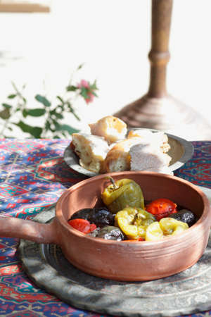 Stuffed goose and stuffed vine leaves in a terracotta pot
