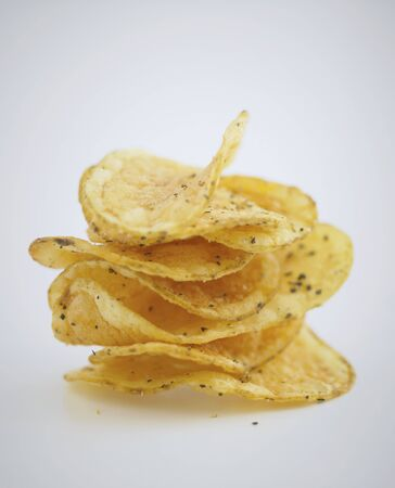 whiteness: A stack of crisps on a white surface