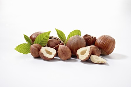 halved  half: Hazelnuts with leaves