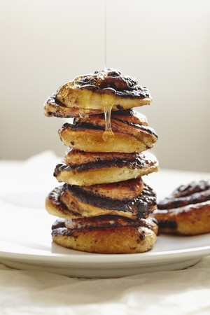 helical: Honey dripping down a stack of sticky buns