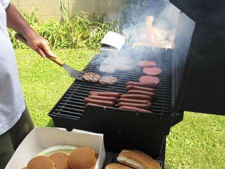 beefburger: Hamburgers and hot dogs on a barbecue