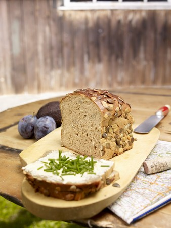 pit fall: Pumpkin seed bread, sliced, on a rustic garden table LANG_EVOIMAGES