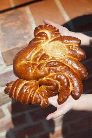A girl with a cockerel-shaped yeast cake