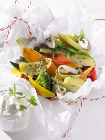 Colourful vegetables with herbs in parchment paper