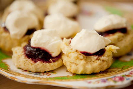 Scones with strawberry jam and cream LANG_EVOIMAGES