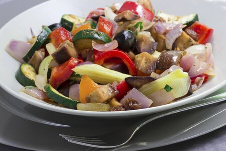Caponata with courgettes, black olives, onions, red and yellow peppers, aubergines and celery