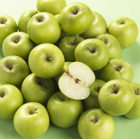 granny smith: Granny Smith apples, one halved