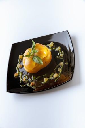 silos: A yellow tomato filled with burrata, pesto and pineapple