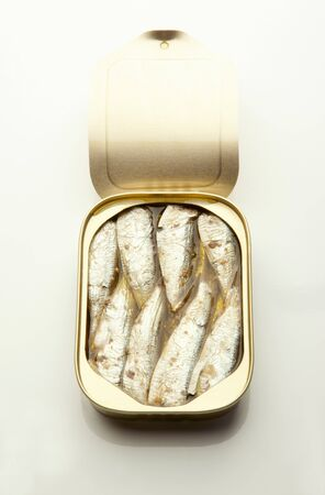 A opened tin of sardines