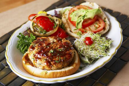 bean sprouts: Salmon burger with pickled peppers and bean sprouts